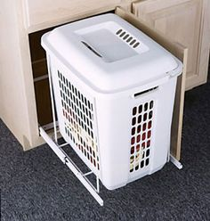 This Roll-Out Cabinet Hamper conserves precious floor space by storing your hamper away in one of your base cabinets. Without a large cumbersome clothes hamper in the middle of the floor your bathroom will look neat and organized.  The hamper features steel furniture grade roller glides that allow the hamper to slide e