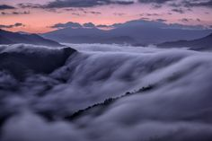Picture of fog rolling over mountains