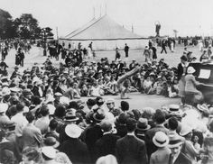 A crowd taking in an acrobatics display at the CNE in 1937! Check out this year's Acrobatic Show, Tic Toc at the Ricoh Coliseum daily at the 2013 CNE! http://theex.com/main/entertainment/aerial-acrobatics-show