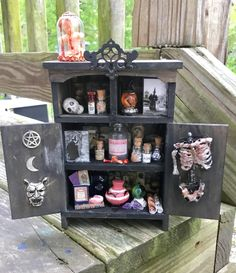 A personal favorite from my Etsy shop https://www.etsy.com/listing/531125279/dollhouse-miniature-witches-cabinet-ooak