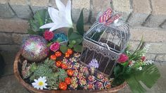 Clay painted mushrooms with dollar store bird cage.. Mini cacti and fake flowers .....