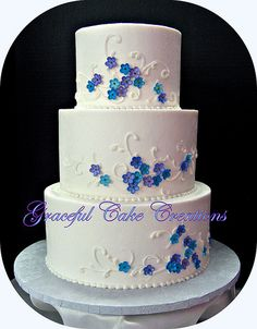 White Buttercream Wedding Cake with Purple and Blue Flowers