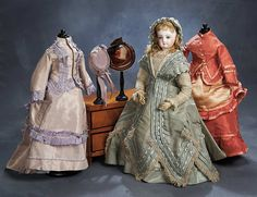 Samples of Dresses to be Made for Betsy. Theriault's Beautiful French Bisque Poupee by Emile Jumeau with Three Costumes