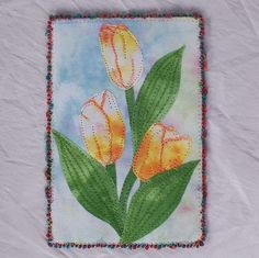 """Spring Tulips""-Yellow Is an Art Quilt Postcard, 4x6 in size. Tulip flowers and leaves cut from my own hand dyed cotton fabric are appliqued over another piece of dyed fabric. Accents on the flower pe"