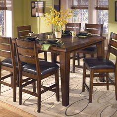 Larchmont Butterfly Leaf Pub Table by Signature Design by Ashley   Part of the Larchmont Collection Sku: D442-32 Dimensions: Width: 54  x  Depth: 36  x  Height: 36 Store Availability: In Stock and On Display Compare At Price: $1,019.99 Sale Price: $539.99