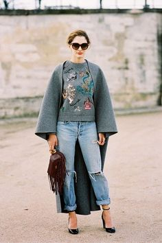 Beautiful grey cape and distressed denim street style look.