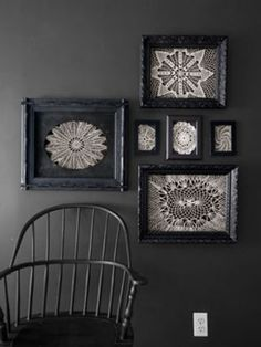 Just as Charlotte's webs attracted admirers, so too will these delicate displays. Using tape or tacks, secure vintage doilies to the open backs of black frames. The white crochet looks especially moody hung on a deep-hued wall.