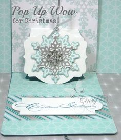 Inside of the pop up with a snowflake ornament surprise.