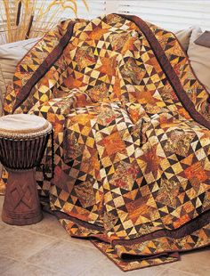 Enjoy the Smoky Point Star digital pattern from Love of Quilting.Beautiful brown, rust, and gold prints capture the colors of autumn in this patchwork.Quilt designed by Jayne CornwellQuilt size: x rating: Interm Star Quilt Patterns, Star Quilts, Scrappy Quilts, Batik Quilts, Canvas Patterns, Primitive Quilts, Civil War Quilts, Halloween Quilts, Fall Quilts