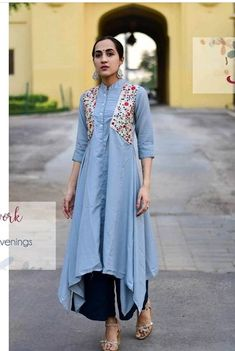 Jacket style asymetric cotton Kurti with fine detailing.