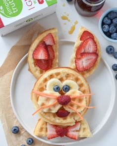 A face decorated with fresh fruit on top of gluten free waffles, this Easter Bunny waffles breakfast is sure to start your kids