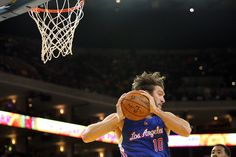 Description of . Los Angeles Clippers' Spencer Hawes (10) gains a rebound against the Golden State Warriors in the first half of a preseason NBA game at Oracle Arena in Oakland, Calif., on Tuesday, Oct. 21, 2014. (Ray Chavez/Bay Area News Group)