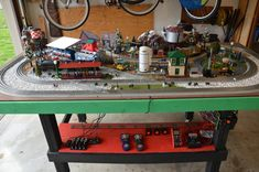 layout on custom built table for garage. Lionel Trains Layout, Model Trains, Toy Trains, Electric Train Sets, Cool Garages, Train Room, Basement Layout, Train Table, Getting Played