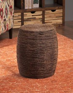 """Woven seagrass creates the natural look of the Colquitt ottoman. Great for use as a side table, this ottoman adds a warm honey tone to any room. Dimensions: 19"""""""