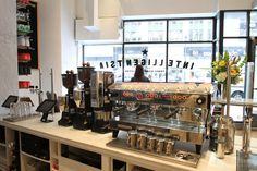 A mix of old and new. Espresso beverages will be served from a La Marzocco Linea PB, which is flanked by an additional Modbar steam module for added milk-steaming capacity in busy times. A La Marzocco Volcano Swift auto-dosing and tamping grinder is dedicated to Black Cat espresso, while two Roburs await the single-origin coffee of the moment and a decaf.