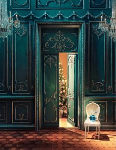 Such a wonderfully grand room at holiday time!!! Bebe'!!! Love the relish blue color and carvings on the wall paneling!!! Take a peak through the open door at the magnificent Christmas tree!!!