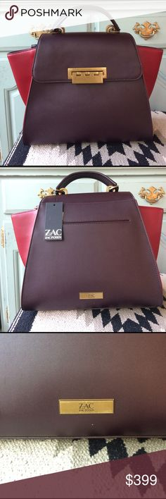 """Zac Posen Large Eartha Leather Satchel NWT Brand new, authentic leather satchel by Zac Posen. Top handle or optional Crossbody strap. This bag is nice and roomy. Exterior slip pocket and one interior zip pocket. Color is a deep purple with burgundy at the sides. Amazing structured bag that really stands out. 12"""" wide at bottom. 10"""" tall plus 4"""" handle drop. Offers considered on this one. No trades please. Zac Posen Bags Satchels"""