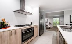 Quality finishes including Caesarstone benchtops, 900mm stainless steel appliances and a tiled splashback