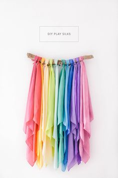 DIY Play Silks - A simple tutorial to dye your own silkies for hours of open ended play. These Waldorf inspired silks also make the best travel toys!
