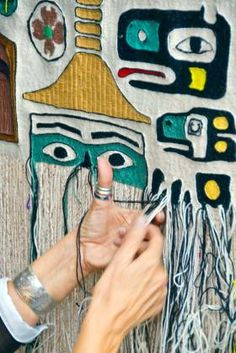 Chloe French weaves her first Chilkat robe during a weavers' demonstration at the Sharing Our Knowledge Conference at Centennial Hall in 20...