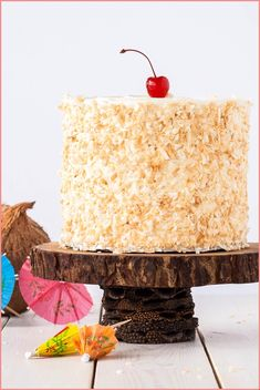 This Pina Colada Cake turns your favourite tropical cocktail into one  delicious dessert! Rum flavoured cake and frosting paired with pineapple  filling and  - #This #Pina #Colada #Cake #turns #your #favourite #tropical #cocktail #into #one # #delicious #dessert! #Rum #flavoured #cake #and #frosting #paired #with #pineapple # #filling #and # -