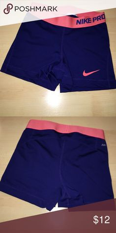 Nike shorts Nike pro shorts. Blue with a pink waistband. Size tag was cut out but they are a size small. Worn but in great condition. No cracks in lettering and no snags or tears! Nike Shorts