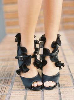 Black, ruffles and peep-toe! Need we say more? http://www.stylemepretty.com/2015/06/16/wedding-day-shoes-worth-showing-off/
