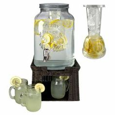 "Serve refreshing lemonades or sweet sangria at your next luncheon with this country-chic beverage dispenser set, featuring a flavor infuser, woven stand, and 6 mason jar-inspired glasses.  Product: 1 Beverage dispenser1 Infuser1 Stand6 Mason jar mugsConstruction Material: Glass, metal and plasticColor: ClearFeatures: 3 Gallon dispenser capacity16 Ounce mug capacityInfuser nests inside dispenserGlasses nest in standDimensions: Dispenser: 24.75"" H x 9"" DiameterMug: 4.75"" H x 2.5"" Diameter"