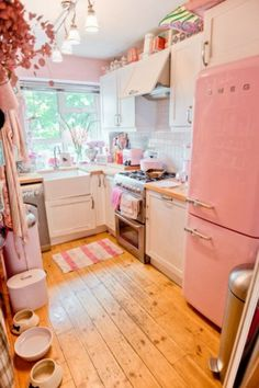 Not a huge fan of the color, but it's still a super cute kitchen!