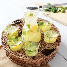 Our chic Veranda Carafe & Glasses Set allows you to transport and serve refreshing sips with ease. This elegant hand blown set includes a simple carafe that holds over 48 ounces, six 12 ounce glasses and a two piece wicker serving tray with a top that conveniently nests each glassware item. Set comes packaged in Olive & Cocoa® gift wrap with ribbon