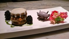 cardamom spice cake layered with rhubarb-angelica compote, topped with creme…