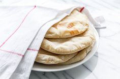 The best part of making homemade pita bread? Watching it bake in the oven! Find the recipe by @loveandoliveoil on our blog.