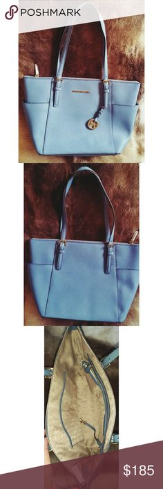 Michael Kors East West Jet Set zip-top tote. NWOT Great Michael Kors jet set tote in light blue. Bag measures 15.5 by 10 by 4.5 inches deep.   New without tags. 1 small mark on the back see picture hardly noticeable. Great Value and great gift for this holiday season :-) Michael Kors Bags Totes