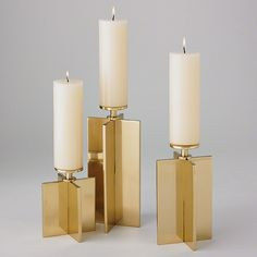 A stark statement in brass, the Axis candleholder illustrates less-is-more. Made of solid polished brass, the simple metallic candleholder peaks with a sharp stem, so the candles appear to be floating