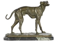 A FRENCH PATINATED FIGURE OF A HOUND,  INSCRIBED 'BARYE',