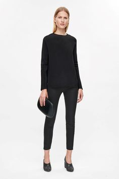 Designed with metal ankle zips, these slim-fit trousers are made from stretchy cotton-mix. A clean silhouette, they are cut to sit on the waist and a comfortable elastic waist. Cos Trousers, Slim Fit Trousers, Trousers Women, Pants For Women, Clothes For Women, Work Pants, Minimalist Fashion, Black Pants, Normcore