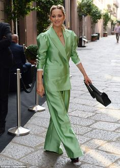 Passion for fashion: She teamed her suit - which featured billowing trousers and a perfect...