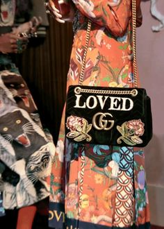 """Flower and tiger prints and the new GG Marmont velvet bag with """"Loved"""" embroidered in pearls and floral appliqués from Gucci Pre-Fall 2017."""