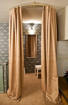 Mare retail store boutique interior - Dressing Room Ideas & Inspiration - Love the floor-grazing beige / neutral colored curtains