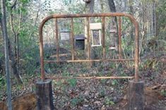 Salvaged metal head board turned birdfeeder station. From Junkmarket style.....some creative people on this site!!