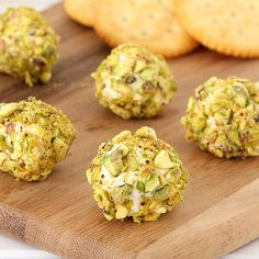 Little heavenly bites of Goat Cheese, Bacon, and Pistachio Truffles paired with wine will elevate your next tailgating party.