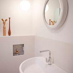Baños de estilo moderno por IJzersterk interieurontwerp