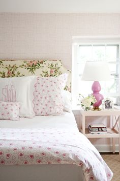 girly bedroom, floral upholstered headboard, pink gourd lamp