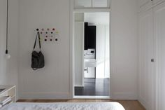 Exemplar cottage's master bedroom, again utilizing white walls and timber flooring. Opens into WWW and Bathroom.