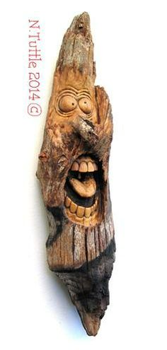 """Nancy Tuttle is a well established artist who carves incredible caricatures and sculptures out of wood that might otherwise go to waste. Describing this piece called 'Wood Wacky', she said: """"He got a little scorched somewhere along the way but the wood inside is nice and solid. I left a little branch uncarved for his nose."""""""