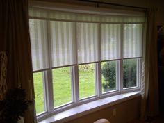close fitting shades in this bow window with draperies outside.  bow window treatments   another Bow window treatment   For My Future Home