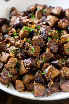 These seared steak bites are cubes of sirloin steak cooked to perfection in a garlic butter sauce. An easy meal or party snack that's ready in just minutes! If you've got meat lovers in your life, you HAVE to try these garlic butter steak bites. Grilled Steak Recipes, Grilling Recipes, Cooking Recipes, Cooking Tips, Cooking Pork, Sirloin Steak Recipes, Recipes With Steak, Deer Tenderloin Recipes, Crockpot Steak Recipes