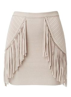 Viscose/nylon Crepe Fringe Mini Skirt.   Slim fitting silhouette features an internal elasticised waistband, above the knee hem in an all over crepe knit fabrication complete with front body fringe detail. Available in Mushroom as shown.