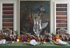 Preparing for Thanksgiving - The center of the table, runner fashion, is decorated with clementines, grapes, lady apples, pears, persimmons, and mini-pineapples from the supermarket, with a sprinkling of unshelled nuts, pinecones, and a final dusting of (faux) snow. - Carolyne Roehm