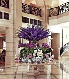 Now that is my kind of floral arrangement! Petals in every shade of purple provide a royal welcome to Four Seasons Hotel Amman. Deco Floral, Arte Floral, Hotel Flower Arrangements, Flower Decorations, Wedding Decorations, Front Flower Beds, Hotel Flowers, Flower Bed Designs, Corporate Flowers